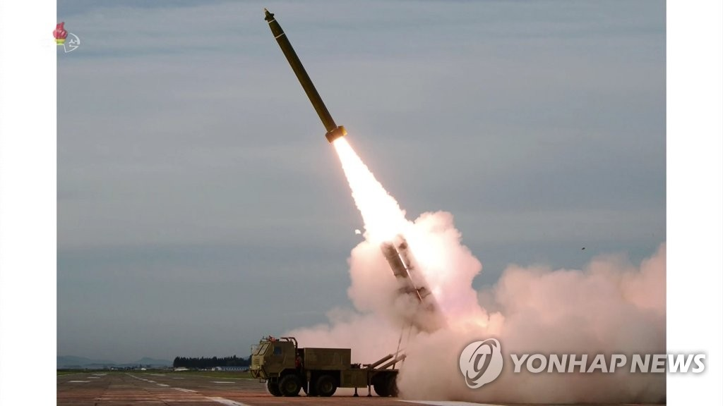 This photo, captured from the North's Korean Central TV Broadcasting Station on Aug. 25, 2019, shows a projectile fired by North Korea the previous day. The North successfully tested a newly developed super-large multiple rocket launcher under the guidance of leader Kim Jong-un, the Korean Central News Agency said. (For Use Only in the Republic of Korea. No Redistribution) (Yonhap)