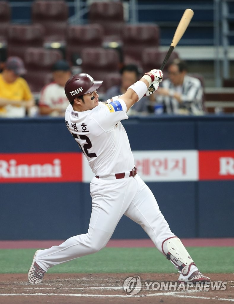 In this file photo from Aug. 29, 2019, Park Byung-ho of the Kiwoom Heroes takes a swing against the Lotte Giants in the bottom of the fourth inning of a Korea Baseball Organization regular season game at Gocheok Sky Dome in Seoul. (Yonhap)