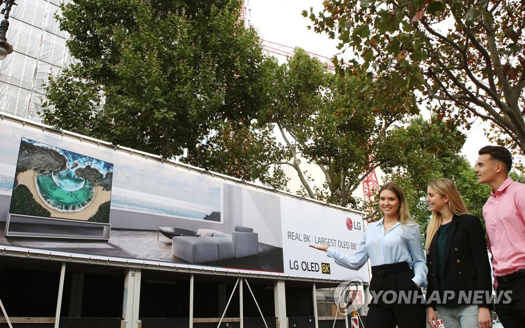 Models introduce LG Electronics Co.'s billboard ad for its 8K OLED TV to be displayed at IFA in Berlin in this photo provided by the company on Sept. 4, 2019. (PHOTO NOT FOR SALE) (Yonhap)