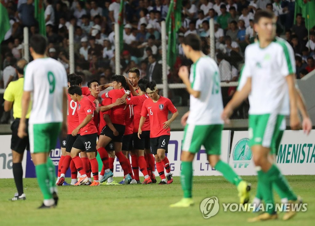 South Korean players (in red) celebrate their second goal against Turkmenistan during the teams' Group H match in the second round of the Asian qualification for the 2022 FIFA World Cup at Kopetdag Stadium in Ashgabat, Turkmenistan, on Sept. 10, 2019. (Yonhap)
