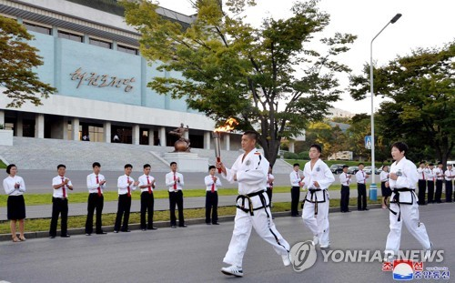 Torch ignited in N. Korea for martial arts competition