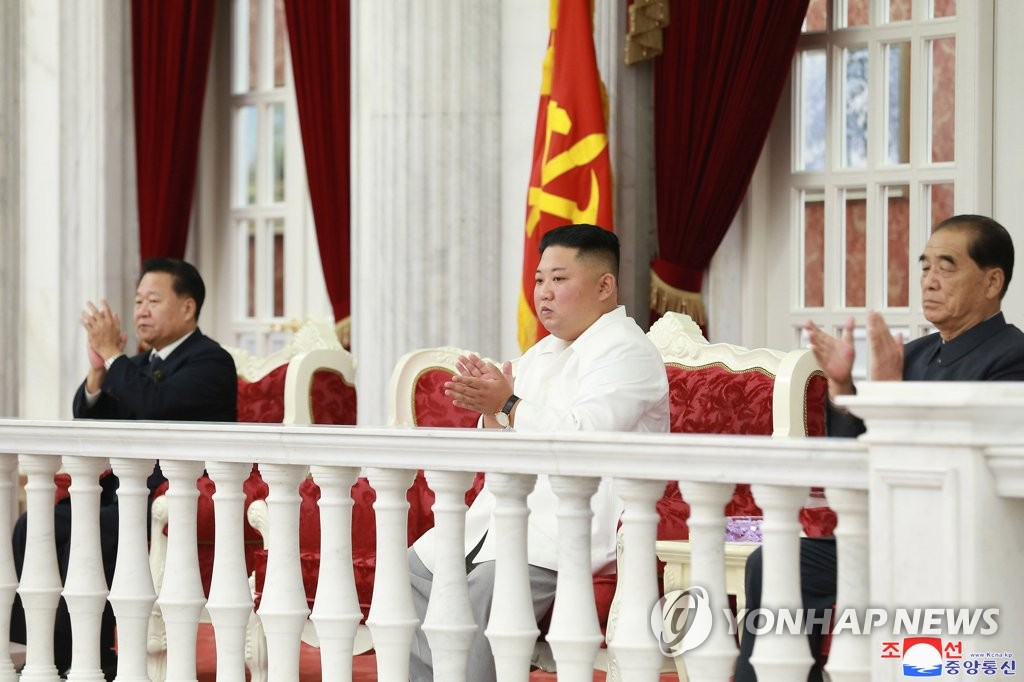 In this file photo, taken Oct. 10, 2019, and released by the Korean Central News Agency the next day, North Korean leader Kim Jong-un (C) watches a performance celebrating the 74th founding anniversary of the Workers' Party of Korea in Pyongyang. (For Use Only in the Republic of Korea. No Redistribution) (Yonhap)