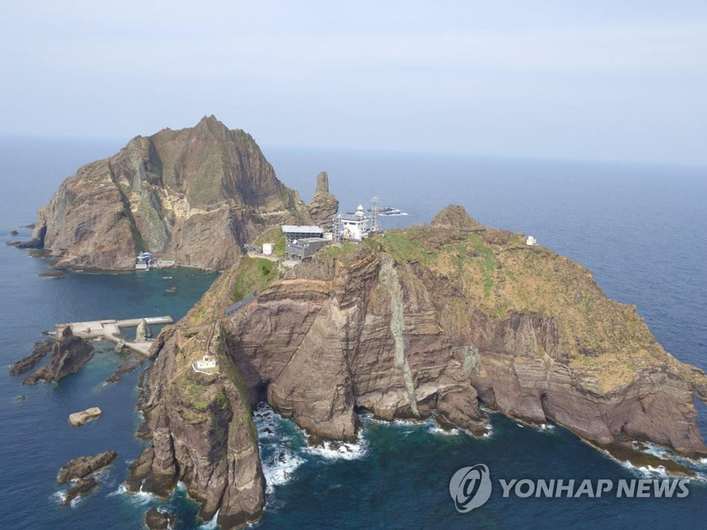 This photo shows an aerial view of South Korea's easternmost islets of Dokdo in the East Sea. The National Research Institute of Cultural Heritage took the photo during a drone survey on Oct. 22, 2019. (PHOTO NOT FOR SALE) (Yonhap)