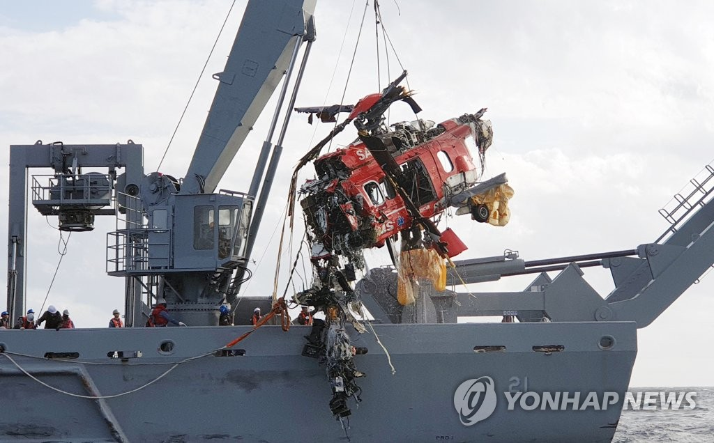 A destroyed rescue helicopter is salvaged from waters in the East Sea by a Navy vessel on Nov. 3, 2019, four days after the crash that happened shortly after its takeoff from the easternmost islets of Dokdo, in this photo provided by the Donghae Coast Guard. (PHOTO NOT FOR SALE) (Yonhap)