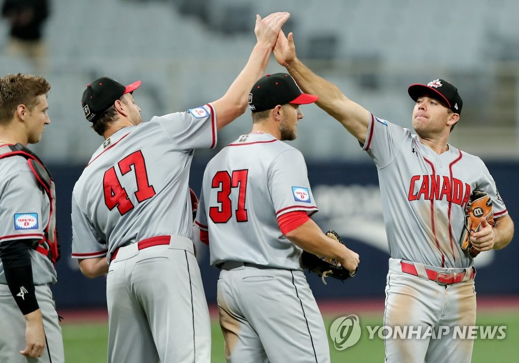 Canadian players celebrate their 3-0 victory over Cuba in Group C action at the Premier12 at Gocheok Sky Dome in Seoul on Nov. 6, 2019. (Yonhap)
