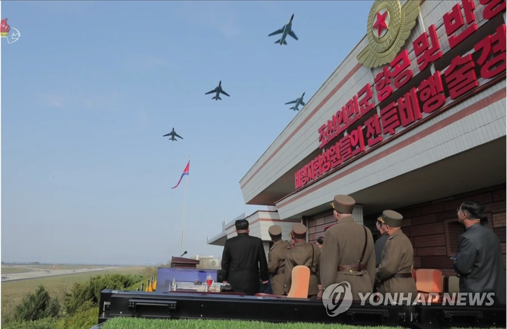 N. Korean leader watches air show