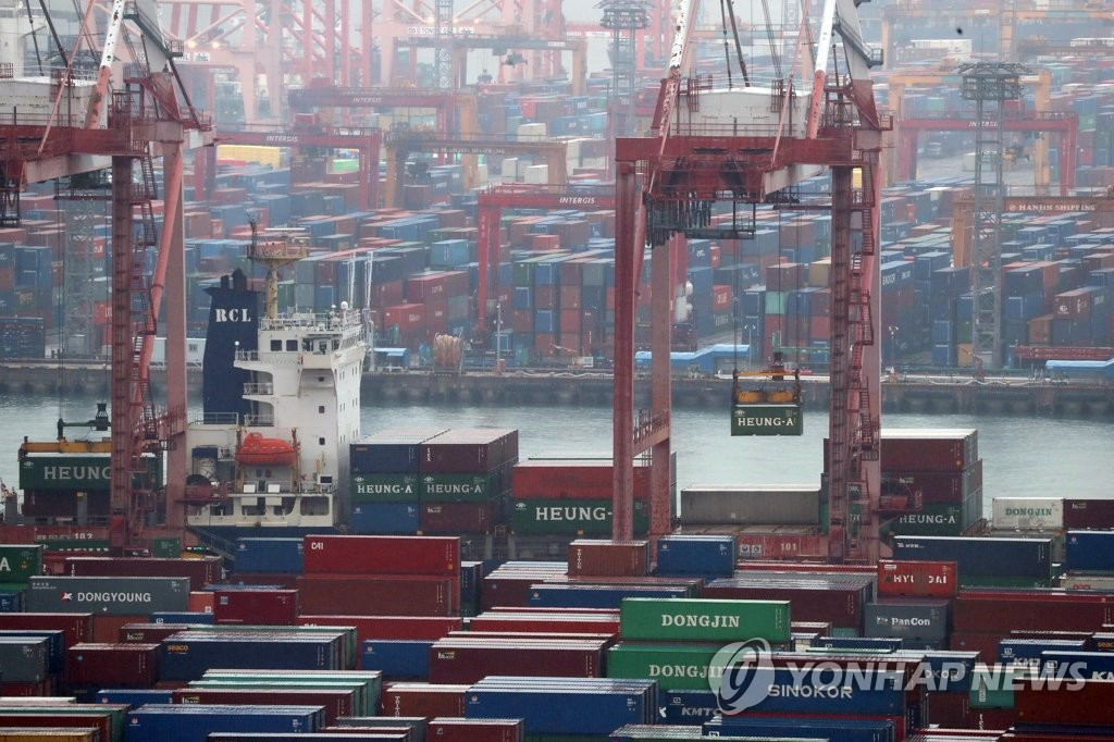 The file photo, taken Dec. 1, 2019, shows export-import containers sitting at South Korea's largest seaport in Busan, located some 450 kilometers south of Seoul. (Yonhap)