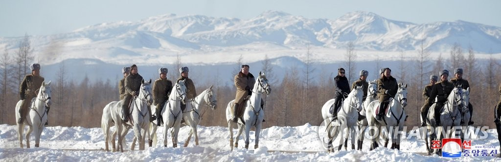 This photo, released by the Korean Central News Agency on Dec. 4, 2019, shows North Korean leader Kim Jong-un (C), alongside the North's senior officials, riding a white horse up a snow-covered Mount Paektu, a volcano on the North Korean-Chinese border. Kim looked around revolutionary battle sites on the highest peak on the Korean Peninsula, considered sacred by Koreans. (For Use Only in the Republic of Korea. No Redistribution) (Yonhap)