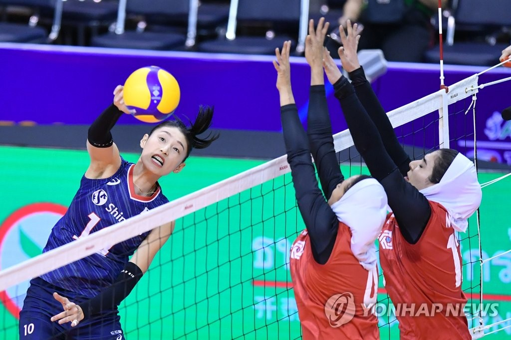 In this photo provided by FIVB on Jan. 8, 2020, Kim Yeon-koung of South Korea (L) hits a spike against Iran in their countries'' Pool B match of the Asian Olympic women''s volleyball qualification tournament at Korat Chatchai Hall in Nakhon Ratchasima, Thailand. (PHOTO NOT FOR SALE) (Yonhap)