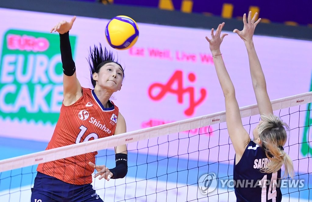 In this photo provided by FIVB on Jan. 9, 2020, Kim Yeon-koung of South Korea (L) hits a spike against Alessya Safronova of Kazakhstan in their countries' Pool B match of the Asian Olympic women's volleyball qualification tournament at Korat Chatchai Hall in Nakhon Ratchasima, Thailand. (PHOTO NOT FOR SALE) (Yonhap)