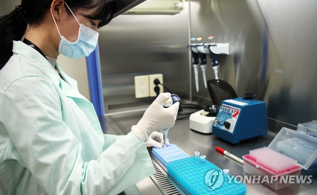 A researcher at Kogene Biotech Co. tests COVID-19 diagnostic reagents at the company's research facility in Seoul on Feb. 5, 2020.