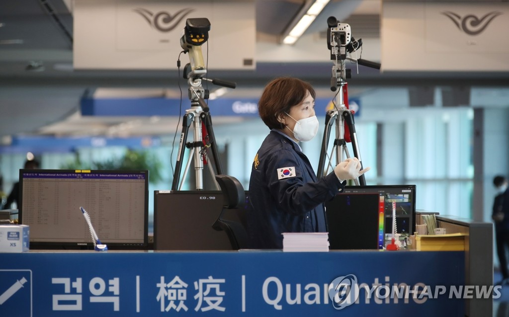 This photo, taken on March 19, 2020, shows a quarantine official working at Incheon International Airport, west of Seoul. (Yonhap)