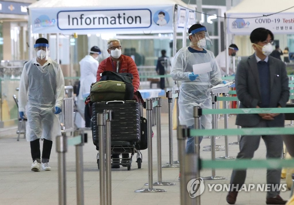 "A person arriving at Incheon Intrnational Airport, west of Seoul, goes to a ""open walk thru"" testing process to check for novel coronavirus infection, on March 26, 2020. The airport, South Korea's main air hub, has taken a severe hit as people avoid travel amid the COVID-19 pandemic. (Yonhap)"