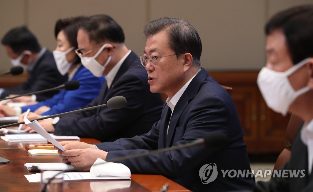 President Moon Jae-in (2nd from R) speaks during a third emergency economic council meeting at Cheong Wa Dae in Seoul on March 30, 2020. (Yonhap)