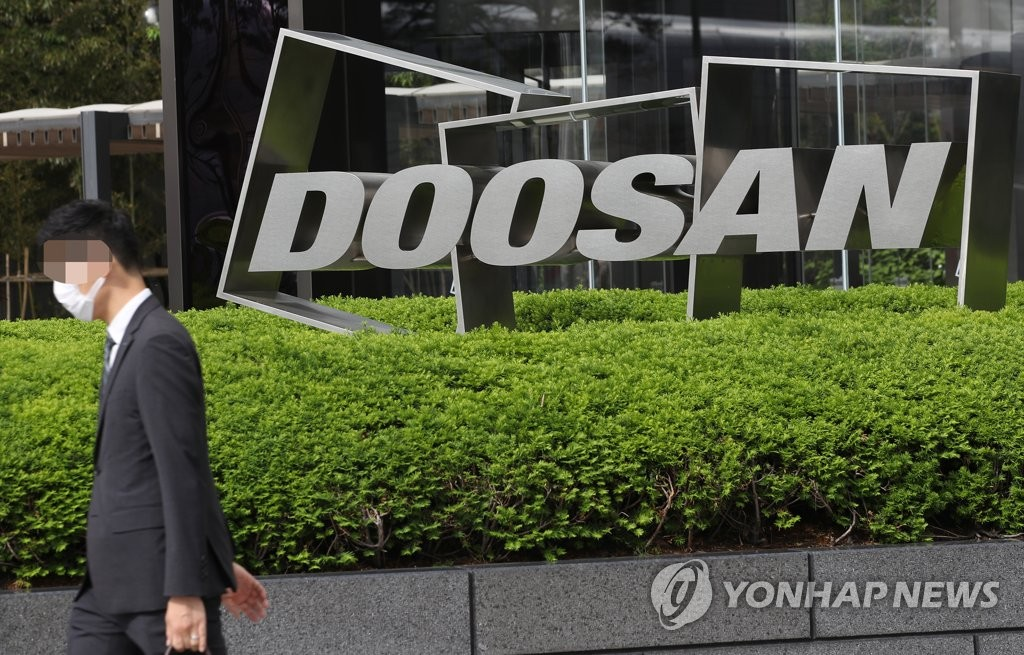 This file photo shows a Doosan Group logo in front of the group's building. (Yonhap)