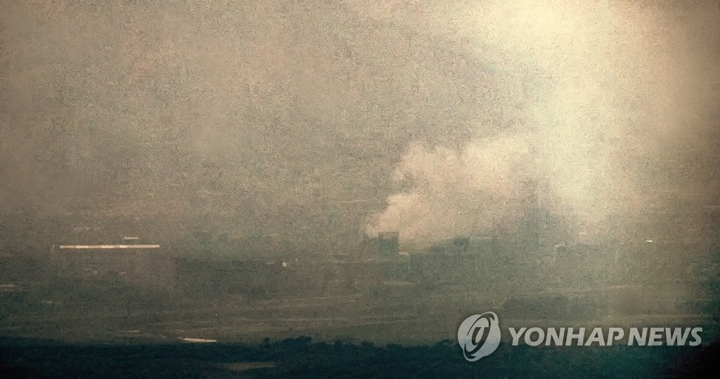 "This photo, taken from the South Korean border town of Paju, north of Seoul, shows thick smoke rising from the inter-Korean industrial complex in the North Korean border town of Kaesong on June 16, 2020. Earlier in the day, South Korea's unification ministry said the North blew up the inter-Korean joint liaison office in Kaesong at 2:49 p.m. The explosion came just days after Kim Yo-jong, sister of North Korean leader Kim Jong-un, warned, ""Before long, a tragic scene of the useless North-South joint liaison office completely collapsed would be seen."" (Yonhap)"