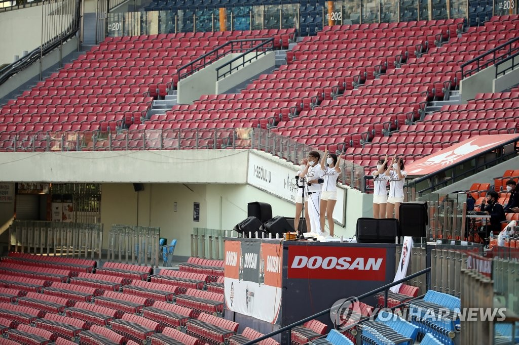 Cheerleaders for the Doosan Bears perform on the stage at an empty Jamsil Baseball Stadium in Seoul during a Korea Baseball Organization regular season game between the Bears and the NC Dinos on June 28, 2020. (Yonhap)