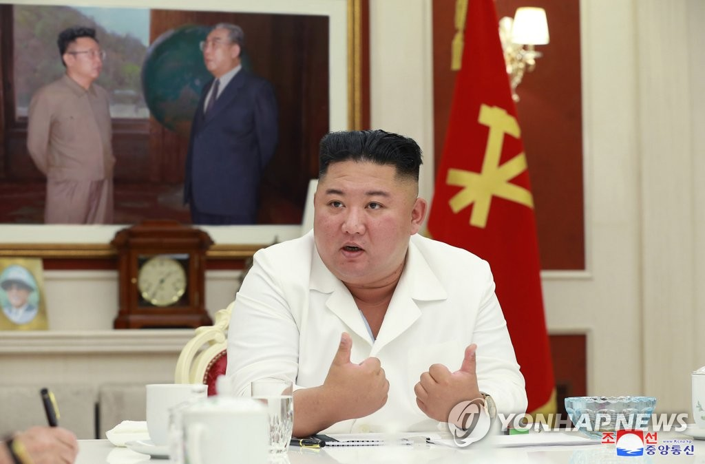 North Korean leader Kim Jong-un speaks during a meeting of the executive policy council of the Workers' Party's central committee in Pyongyang on Aug. 5, 2020, in this photo released by the Korean Central News Agency. The meeting decided to send a special supply of food and funds to Kaesong, which is completely locked down under the state's maximum emergency system due to the spread of the coronavirus. (For Use Only in the Republic of Korea. No Redistribution) (Yonhap)