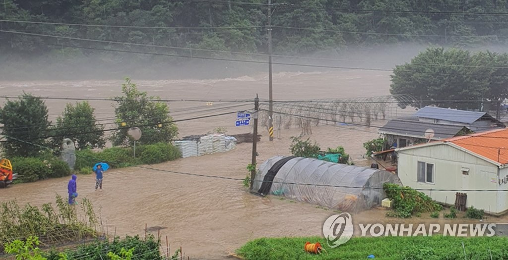 A village in Muju, North Jeolla Province, is inundated due to heavy rains on Aug. 8, 2020, in this photo provided by a local resident. (PHOTO NOT FOR SALE) (Yonhap)