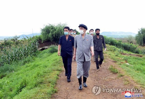 N.K. official inspects flood-hit village