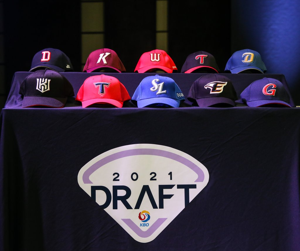 This photo provided by the Korea Baseball Organization (KBO) on Sept. 21, 2020, shows caps for the 10 KBO clubs set on a table during the annual amateur draft in Seoul. (PHOTO NOT FOR SALE) (Yonhap)