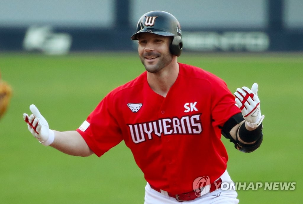 In this file photo from Oct. 11, 2020, Jamie Romak of the SK Wyverns celebrates his double against the Kia Tigers during the top of the ninth inning of a Korea Baseball Organization regular season game at Gwangju-Kia Champions Field in Gwangju, 330 kilometers south of Seoul. (Yonhap)
