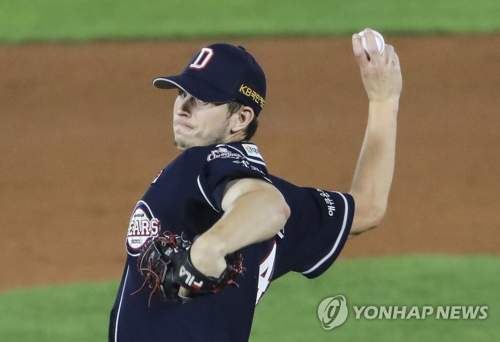 In this file photo from Oct. 20, 2020, Chris Flexen of the Doosan Bears pitches against the Lotte Giants in the bottom of the first inning of a Korea Baseball Organization regular season game at Sajik Stadium in Busan, 450 kilometers southeast of Seoul. (Yonhap)