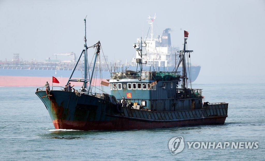 A Chinese fishing boat is sent to South Korea's western port city of Incheon under the escort of a coastal guard ship on allegations of illegal fishing in seas off Socheong Island on Oct. 26, 2020. (Yonhap)