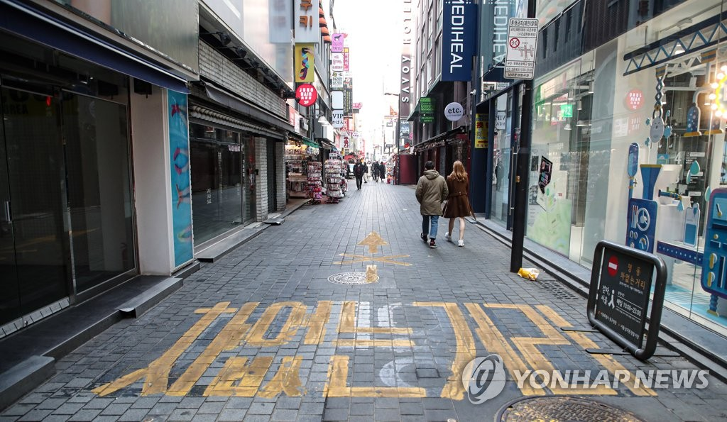 This file photo, taken Feb. 13, 2021, shows an almost empty street of Seoul's shopping district of Myeongdong amid the pandemic. (Yonhap)