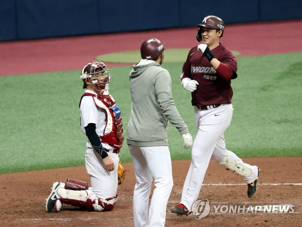 Kim Woong-bin of the Kiwoom Heroes (R) comes home after hitting a two-run home run in an intrasquad spring training game at Gocheok Sky Dome in Seoul on March 2, 2021. (Yonhap)