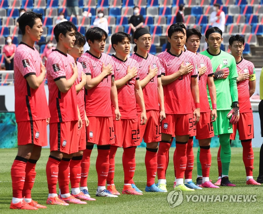 In this file photo from June 13, 2021, members of the South Korean men's football team stand for their national anthem before playing Lebanon in a Group H match in the second round of the Asian qualification for the 2022 FIFA World Cup at Goyang Stadium in Goyang, Gyeonggi Province. (Yonhap)
