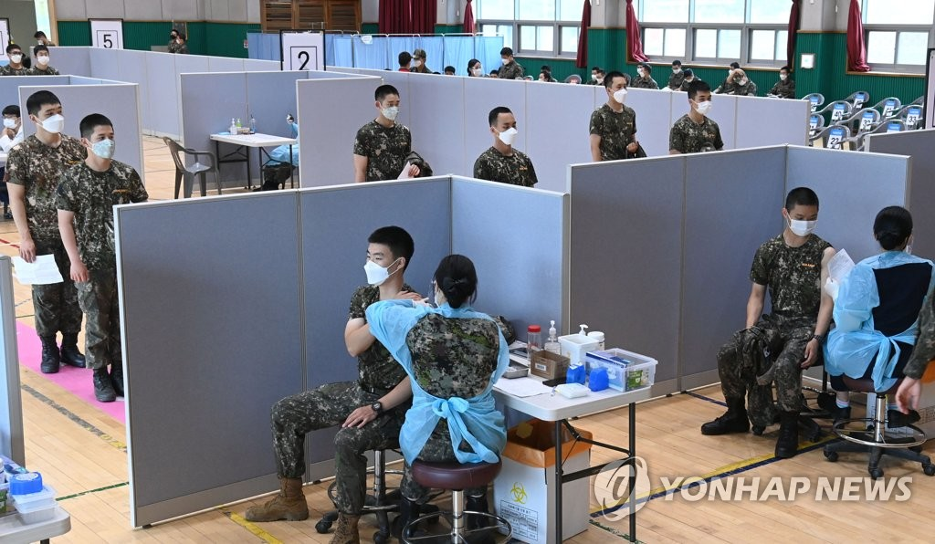 This photo taken on June 24, 2021, and provided by the National Assembly press corps, shows soldiers receiving coronavirus vaccines at a military unit in Goyang, Gyeonggi Province. (PHOTO NOT FOR SALE) (Yonhap)