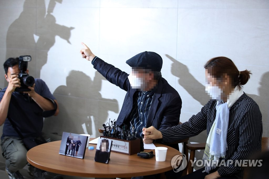 The parents of the late Air Force sexual harassment victim, surnamed Lee, hold a press conference at a military hospital in Seongnam, south of Seoul, on June 28, 2021. (Yonhap)